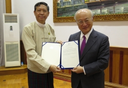 IAEA Director General Yukiya Amano together with Union Minister for Education Dr Myo Thein Gyi,, shows the Instrument of Accession to the RCA (The Regional Cooperative Agreement for Research, Development and Training Related to Nuclear Science and Technology for Asia and the Pacific), during his official visit to Myanmar on 29 June 2017.