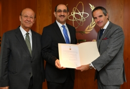 HE Mr. Bassam Sabbagh, Resident Representative of Syria to the IAEA, deposits Syria's Instrument of Accession to the Convention on the Physical Protection of Nuclear Material (CPPNM) and ratification of its Amendment with Rafael Mariano Grossi, IAEA Director General at the Agency headquarters in Vienna, Austria. 5 December 2019. Far left, Dr Ibrahim Othman, Director General, Atomic Energy Commission of Syria.