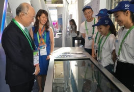 """IAEA Director General Yukiya Amano visited the IAEA booth at the UN pavilion at the Expo 2017 """"Future Energy"""" in Astana, Kazakhstan on 27 August 2017.  Photo Credit: Expo 2017 Astana"""