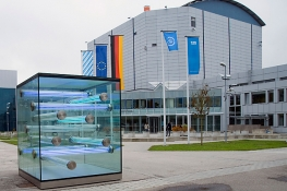 The facility FRM II with the flags of Technische Universitat Muenchen, IAEA, Germany, EU and Bavaria.  (Photo: W. Schuermann/Technische Universitat Muenchen)