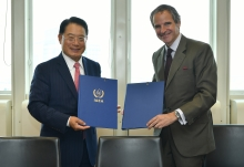 Rafael Mariano Grossi, IAEA Director General and LI Yong, UNIDO Director General, signs the Practical Arrangements between the International Atomic Energy Agency and the United Nations Industrial Development Organization on Cooperation in the area of Peaceful Uses of Nuclear Technology for Inclusive and Sustainable Industrial Development at the Agency headquarters in Vienna, Austria. 12 June 2020