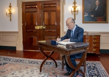 IAEA Director General Yukiya Amano signs Secretary Pompeo's guestbook before their meeting at the U.S. Department of State in Washington, D.C., on April 3, 2019. 