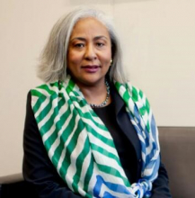"""<br><br>Salwa Dallalah was drawn to the IAEA's mission of promoting the peaceful uses of nuclear science and technologies and held the position of Director of Conference and Document Services from 2015-2020. She says her rise to leadership positions was the result of focus, confidence, passion and hard work. Being able to fall back on a resilient support system, she says, was key to helping her manage the many challenges along the way. <br><br> Salwa is currently an Ambassador for her home country, Sudan. Salwa's advice to young women and future leaders is to """"always stay one step ahead, because the only sure formula for success is hard work. There are no shortcuts to the top ."""""""