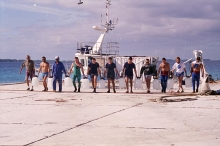 Members of an international team, working on a two-year study of radioactivity at the Mururoa and Fanfataufa Atolls, shown with a collection of ocean water for sampling. 1996. Please credit IAEA/ MOUCHKIN Vadim
