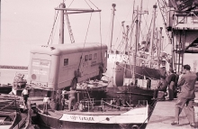 The mobile isotope lab being hoisted on a ship to travel from Montevideo (Uruguay) to Rio de Janeiro (Brazil). 1961. Please credit IAEA