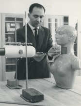A dummy being used to demonstrate the accurate measurement of radioiodine uptake by the thyroid gland. The photo shows the distance being measured between the mock thyroid of the dummy and the crystal of a scintillation detector. December 1961. Please credit IAEA.
