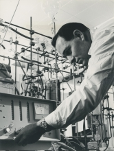 IAEA staff member Lincoln Engelbert operating a scaler on the apparatus for the separation of tritium and hydrogen by gas chromatography at the IAEA laboratory in Seibersdorf. April 1964. Please credit IAEA