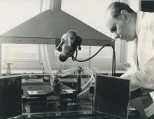 Julian Czakow, IAEA staff member, adjusting the electrode distance of a Polish distillation furnace for spectrographic samples. April 1964. Please credit IAEA