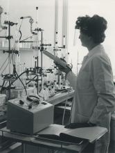 IAEA staff member Helga Axmann analysing for trace elements in plant material by a distillation method in the laboratory in Seibersdorf, near Vienna.  April 1964. Please credit IAEA