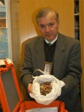 An IAEA inspector shows some of the broken IAEA