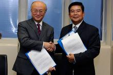 Signing between H.E.  Mr. Suy Sem, Cambodian Minister of Industry, Mines and Energy, and IAEA Director General Yukiya Amano of the Revised Supplementary Agreement concerning the provision of Technical Assistance by the IAEA to the Government of the Kingdom of Cambodia, IAEA, Vienna, Austria, 25 November 2011.