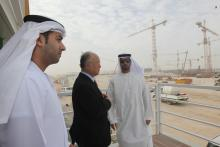 IAEA Director General Yukiya Amano at Barakah nuclear power plant construction site, United Arab Emirates Mr. Mohamad Al Hammadi (right), Chief Executive Officer of the Emirates Nuclear Energy Corporation (ENEC), Ambassador Hamad Al Kaabi (left), Resident  Representative of UAE to the IAEA, and IAEA Director General Yukiya Amano (middle) view construction under way at the Barakah nuclear power plant construction. 29 January 2013. Photo Credit: ENEC