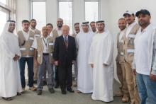 IAEA Director General Yukiya Amano with staff from the Emirates Nuclear Energy Corporation (ENEC) during the Director General's official visit to the Barakah nuclear power plant construction, United Arab Emirates. 29 January 2013. Photo Credit: ENEC