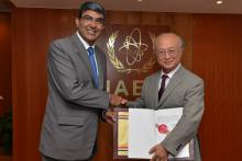 India's Ambassador Rajiva Misra hands over to IAEA Director General Yukiya Amano the instrument of ratification of India's Additional Protocol with the IAEA. IAEA, Vienna, Austria. 25 July 2014.