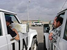 IAEA inspectors head back to Baghdad from a site, over 400 kilometers through the desert. Photo Credits: Pavlicek/IAEA