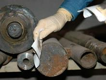 At a machine tool factory, an IAEA inspector takes smear samples. Photo Credits: Pavlicek/IAEA