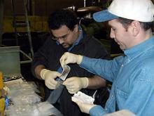 At a machine tool factory, IAEA inspectors take smear samples. Photo Credits: Pavlicek/IAEA