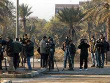 Journalists waiting for inspectors to leave their Baghdad headquarters. Photo Credits: Pavlicek/IAEA