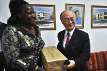 IAEA Director General Yukiya Amano  presents a cancer drug donation to the university of Enugu teaching hospital representative in Abuja. (Photo: A. Sotunde)