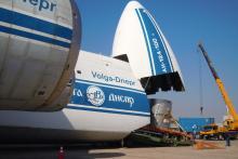 Truck half-way in the plane. (Photo: S. Tozser/IAEA)