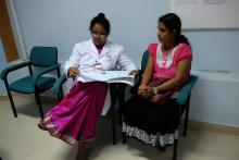 The doctor reviews the medical reports of 33 year-old Chalani Jayarathne, who has recovered from thyroid cancer after being given radioactive iodine. The Nuclear Medicine Unit treats over 200 patients a year for thyroid cancer.