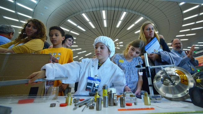Children handle mock radioactive sources at the Long Night of Research on 22 April 2016, Vienna International Centre, Austria