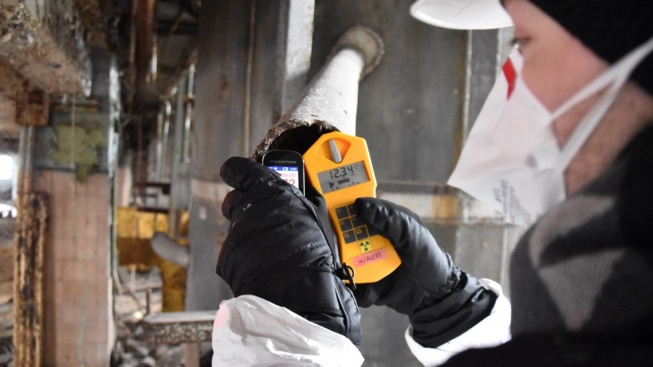 As part of the decommissioning and environmental remediation works, an expert measures radioactivity levels at the former uranium production facilities at the Pridneprovsky Chemical Plant in Ukraine.