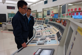 Managing knowledge and experience is key to safe and sustainable operations. Here, two engineers at a control room at China's Qinshan NPP. (Photo: CNNC)