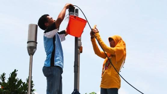 Air sampling in Palangka Raya, Borneo, Indonesia