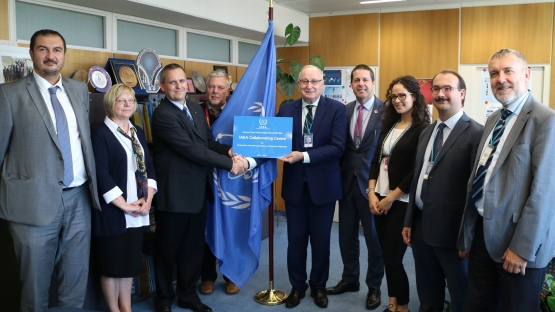 Aldo Malavasi, Deputy Director General and Head of the Department of Nuclear Sciences and Applications, hands over the Collaborating Centre redesignation plaque to Dr. Attila Nagy, Deputy Director of Hungary's National Food Chain Safety Office