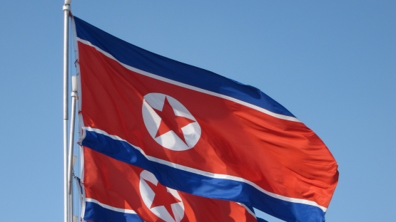 DPRK flag - photo credit Flickr photo by J. Pavelka/(cc by 2.0)