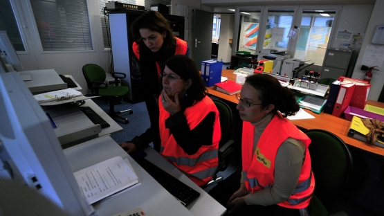 Members of the Response Communications Team at work in the IEC Communications Room during the Full Response Mode Exercise (FRME), IAEA, Vienna, Austria, 21 November 2012
