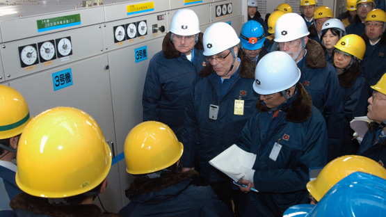 Japanese officials from the Ohi Nuclear Power Plant brief IAEA team members about the plant's battery inverter equipment, part of the plant's safety system, on 26 January 2012