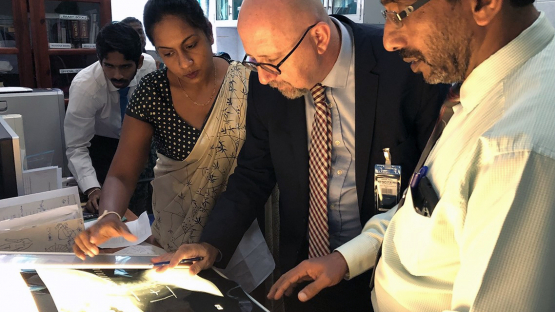 An expert reviewing an x-ray with cancer control staff at the Karapitiya Teaching Hospital in Sri Lanka